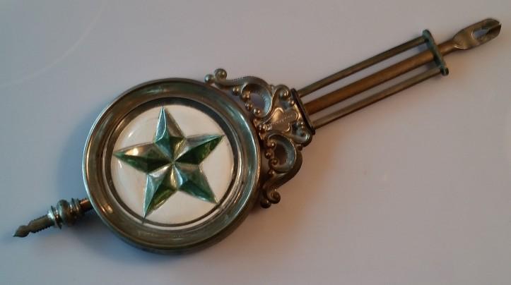 Antique sandwich glass pendulum with a star design